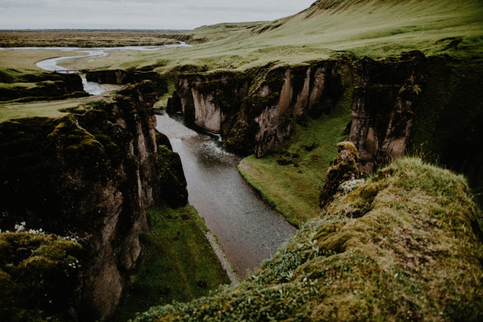 A river and cliffs are located next to the wedding couples apartment.