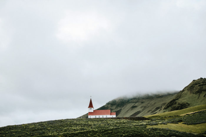 A church is sitting on a rocky plateau.