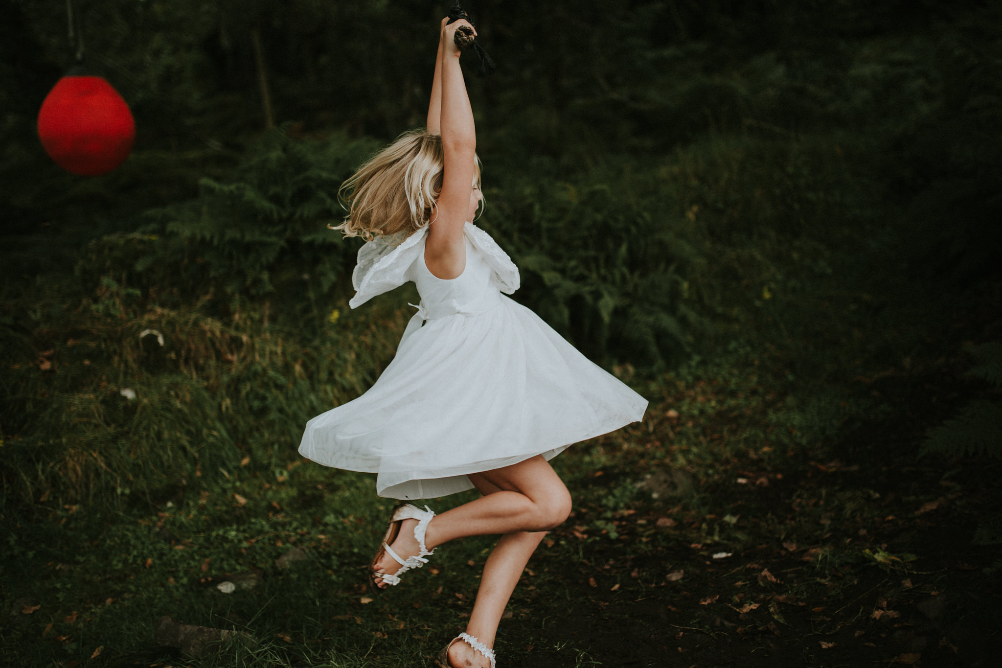 A girl is dancing in the meadow.