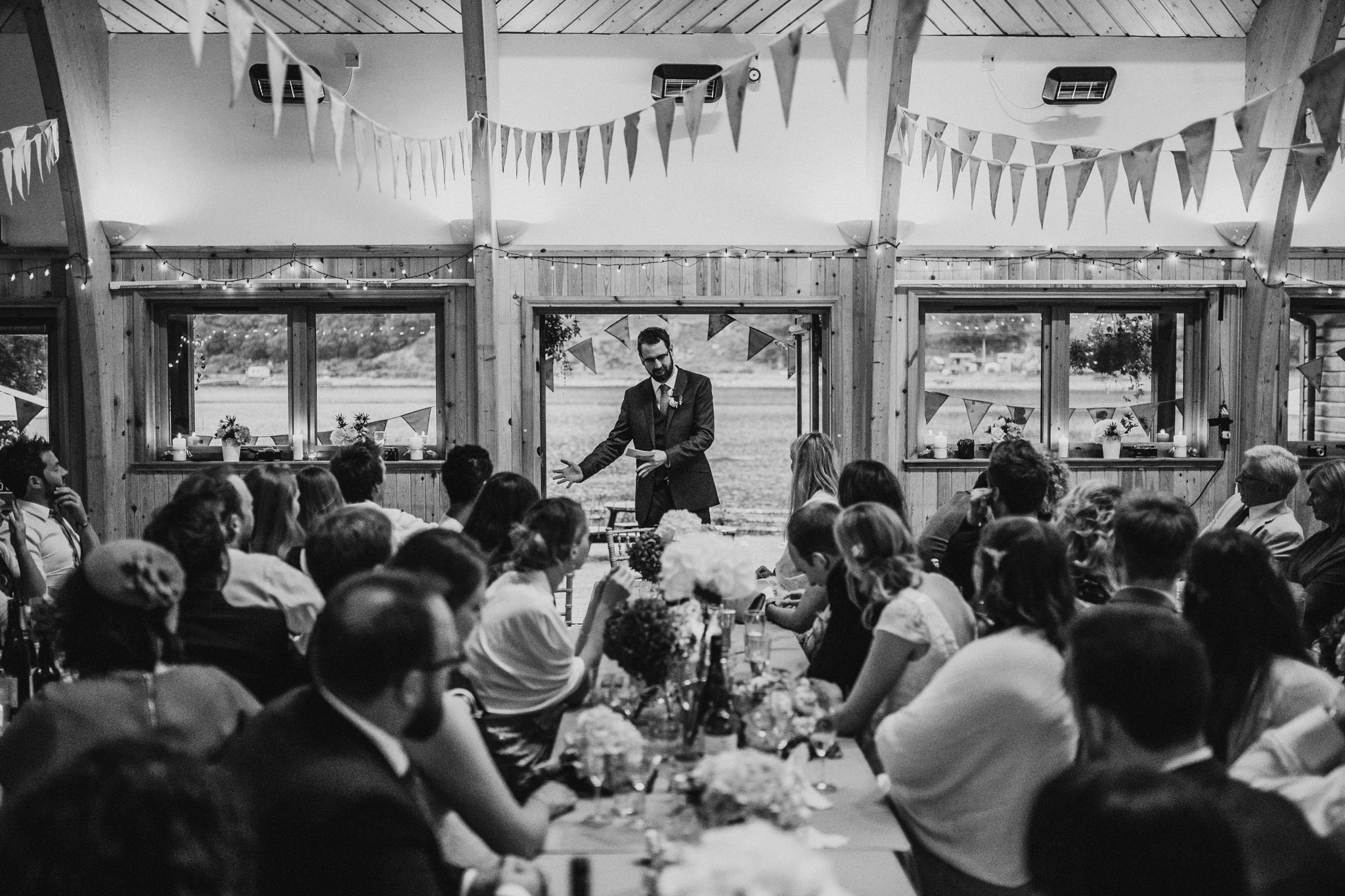 A wedding guest is holding a speech.
