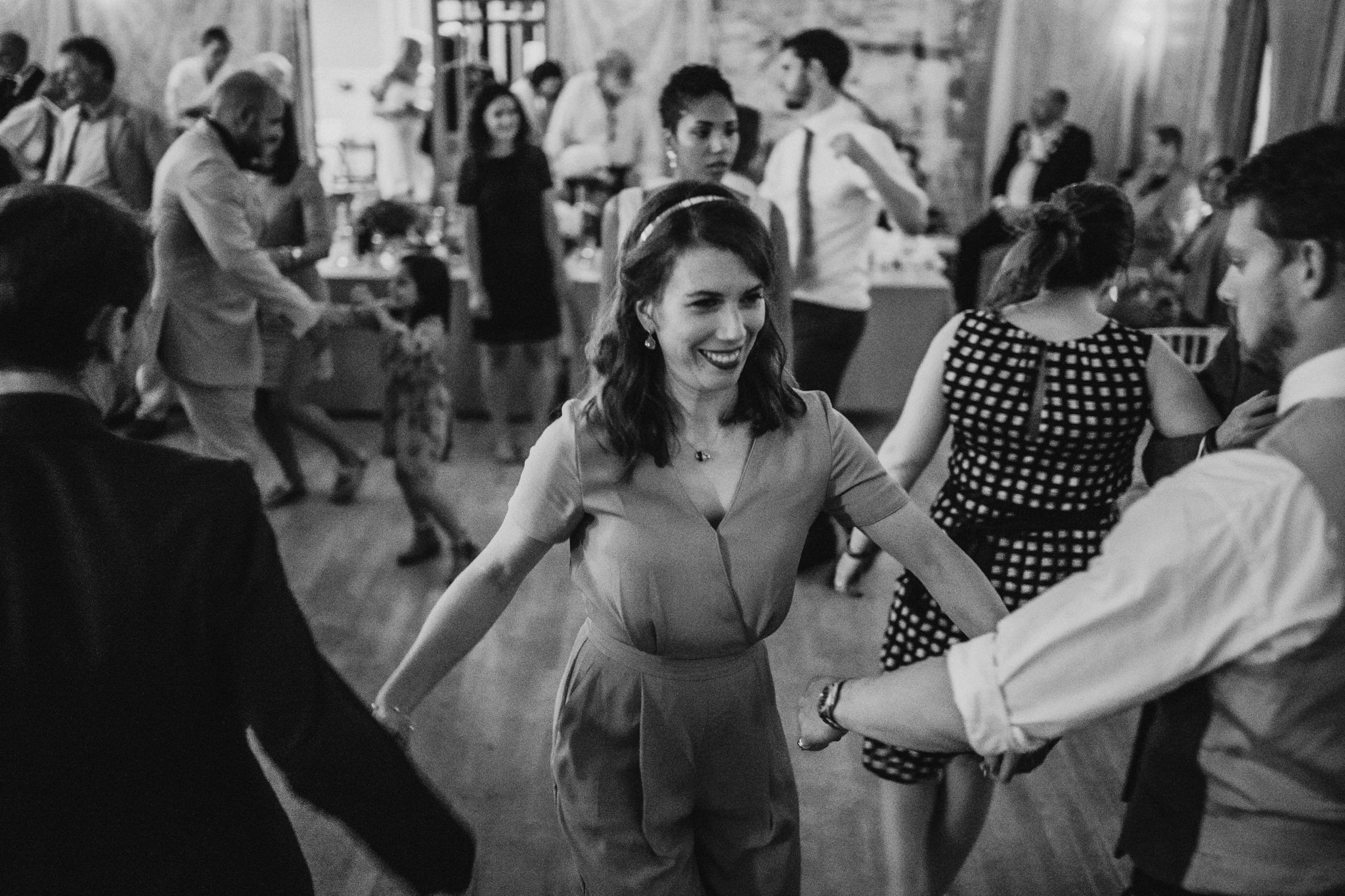 Wedding guests are dancing at the wedding party.