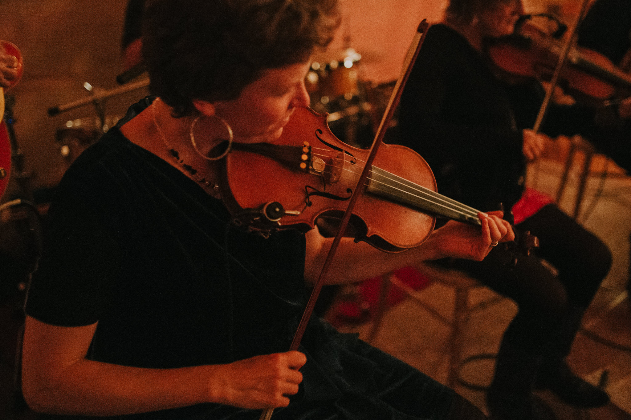 A musician is playing her violin.