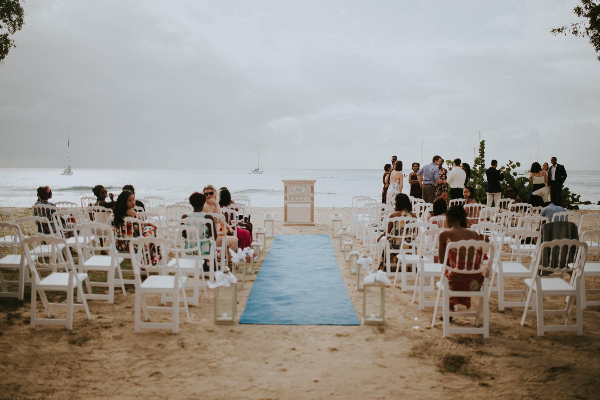 An aisle and chairs are standing right at the beach.