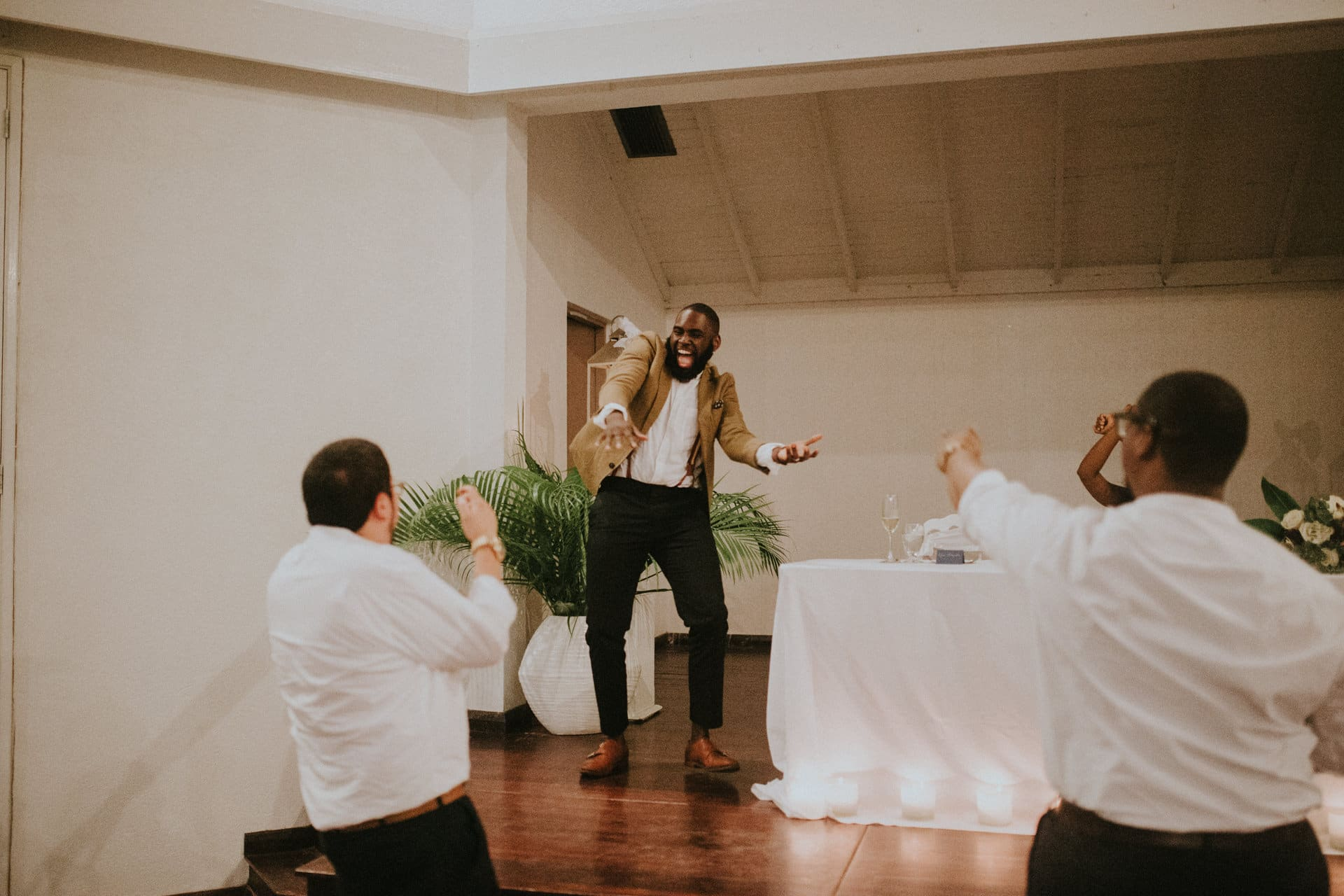 The groom is dancing and laughing.