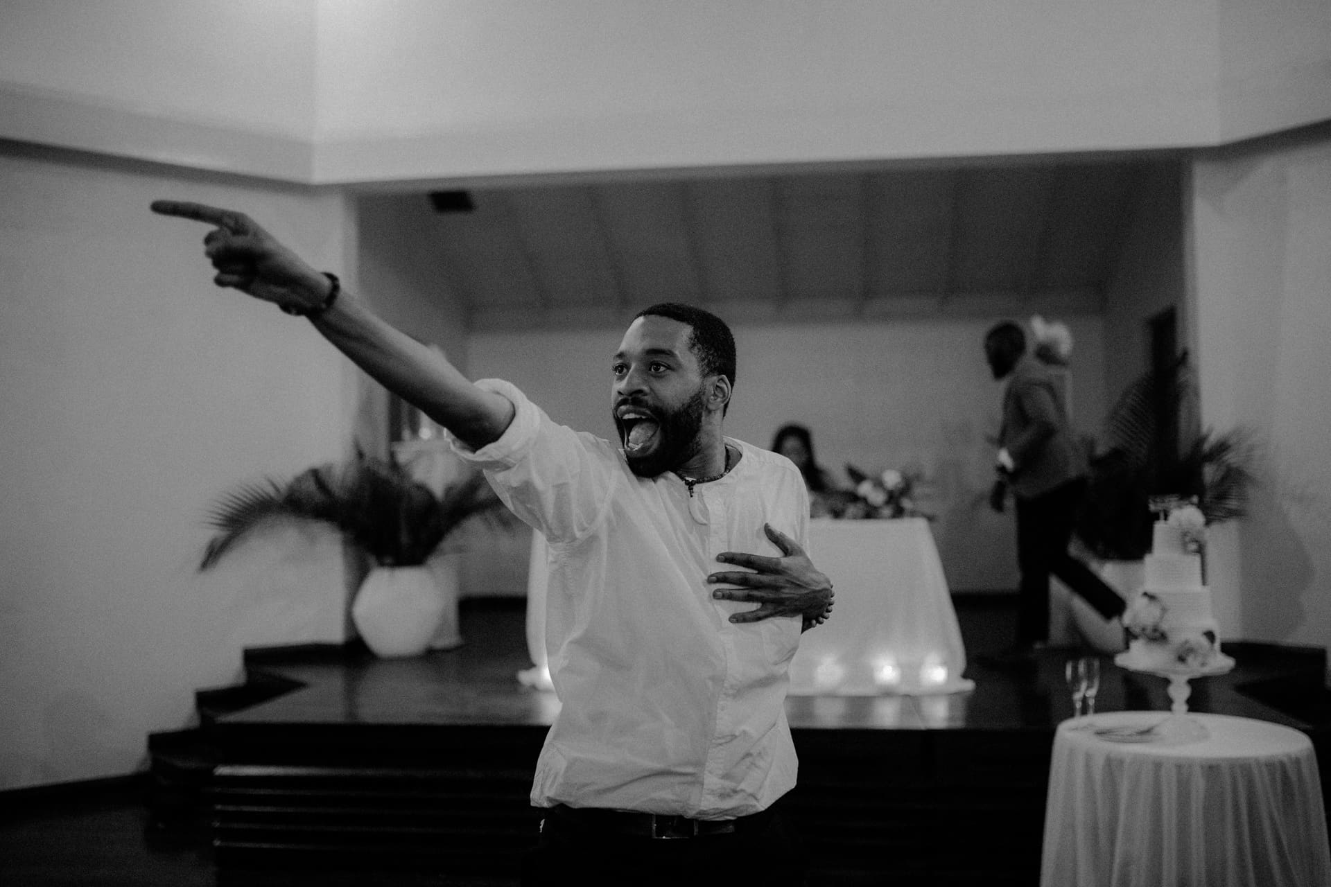 A wedding guest is dancing at the wedding party.