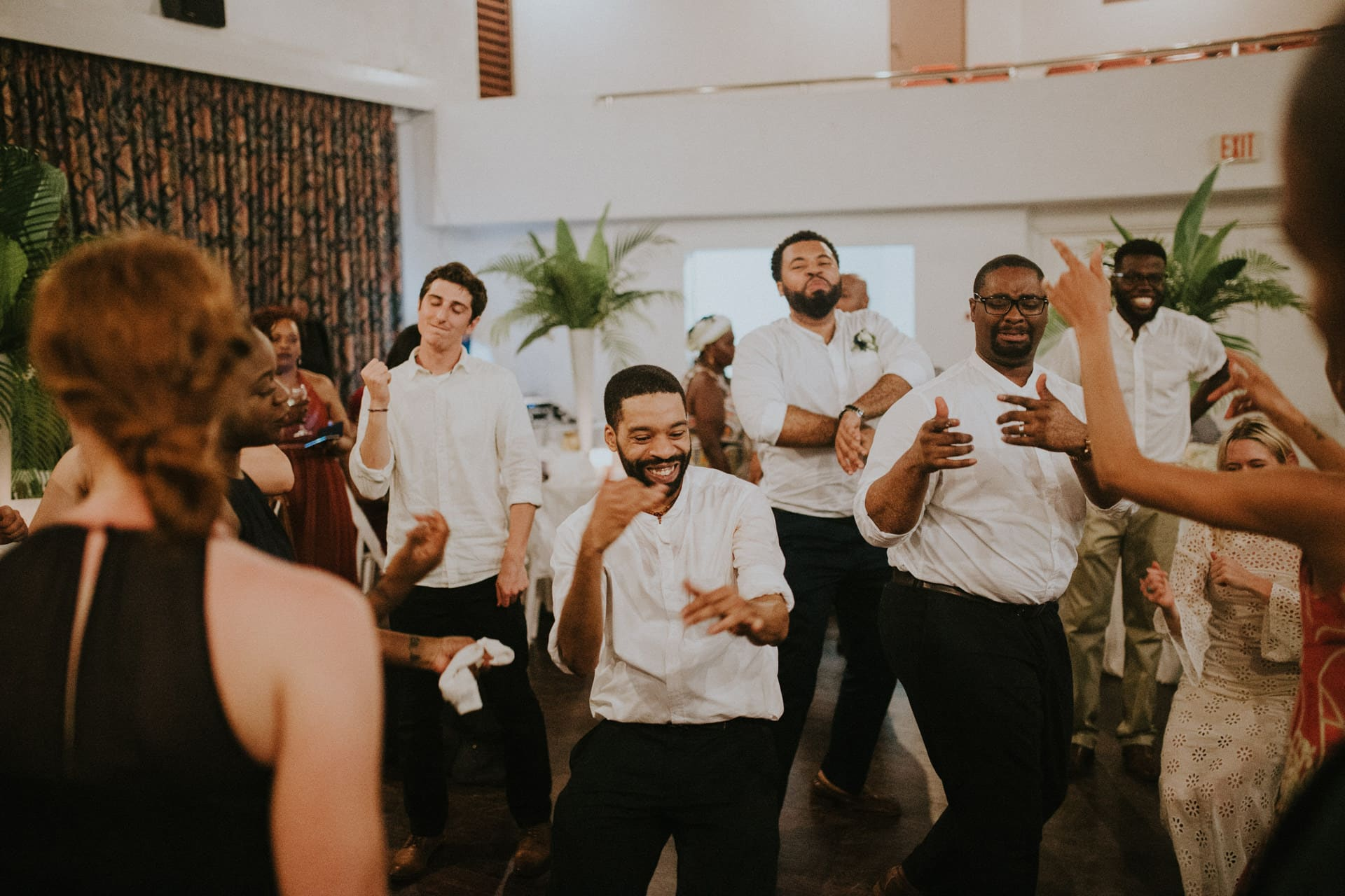 Groomsmen are dancing at the wedding party.