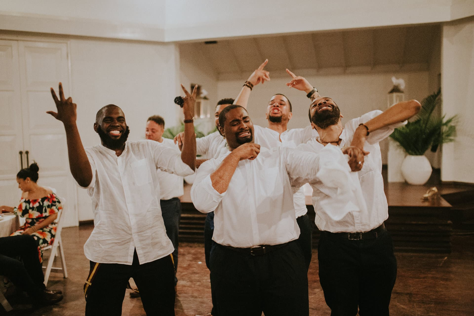 Groomsmen are dancing at the wedding.