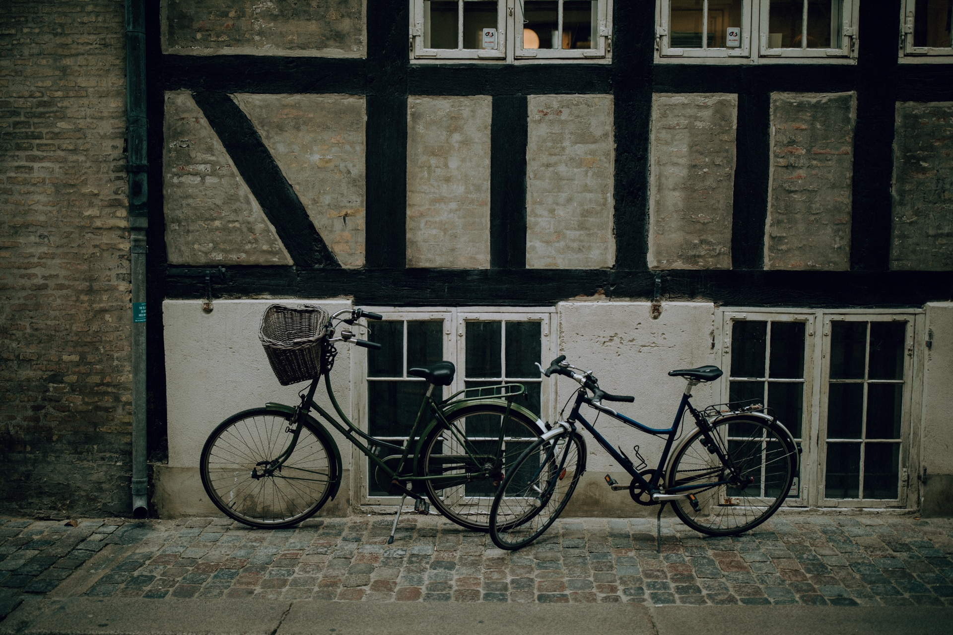 This Copenhagen Wedding picture shows two bikes standing in front of an old building.