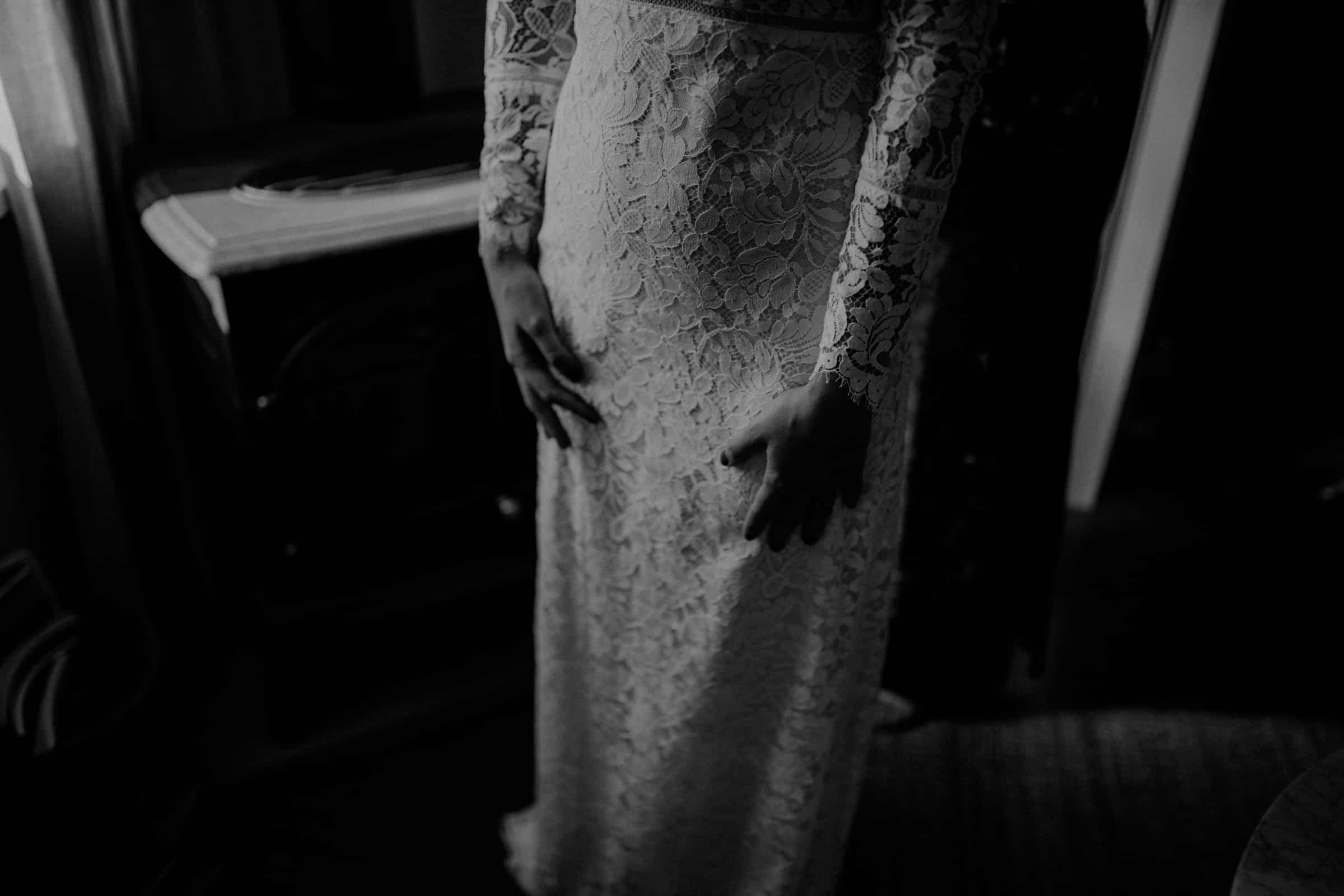 This closeup shows the bride in her wedding dress.