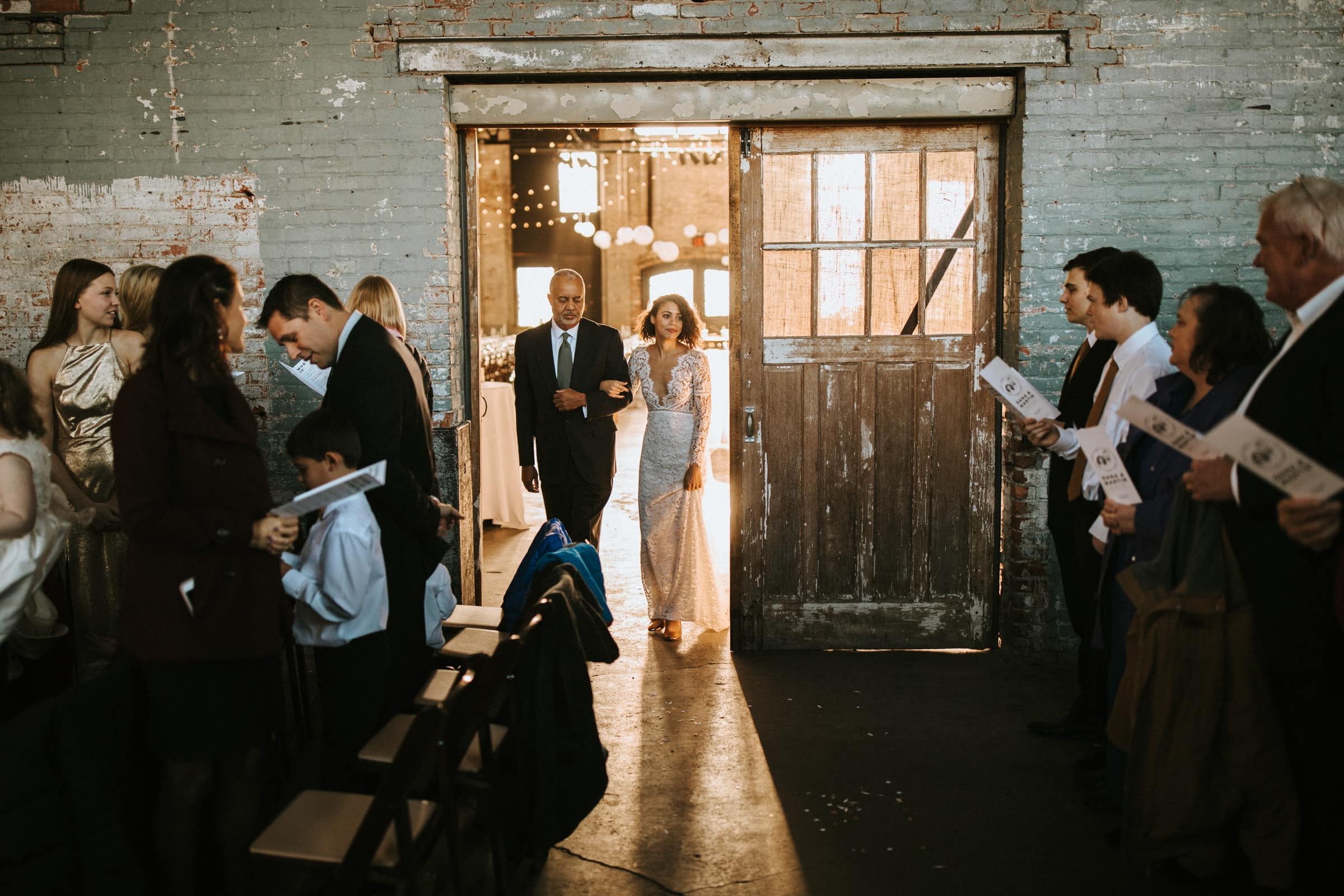 The bride and her father are entering the wedding venue.