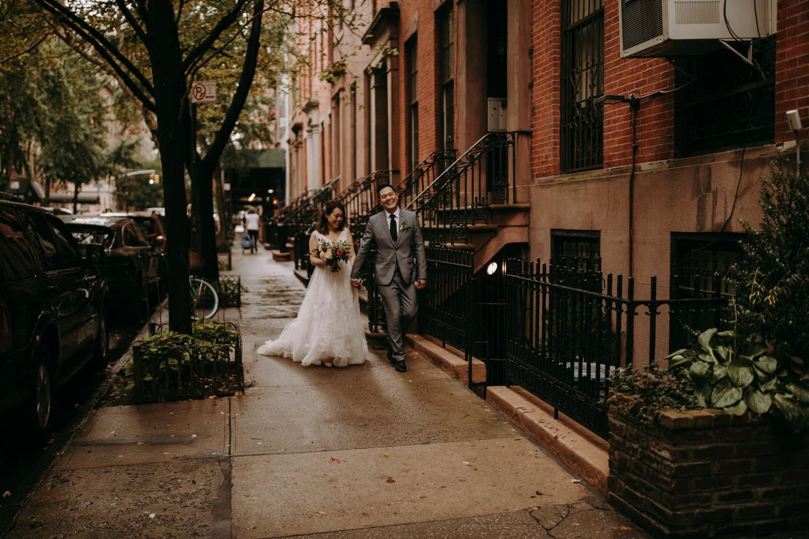 The wedding couple is walking through the streets of NYC.