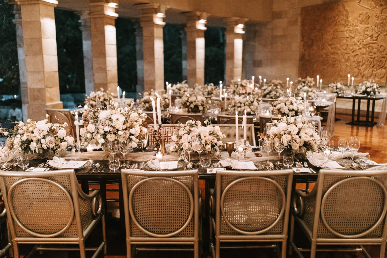 This picture shows a room filled with wedding tables and chairs.
