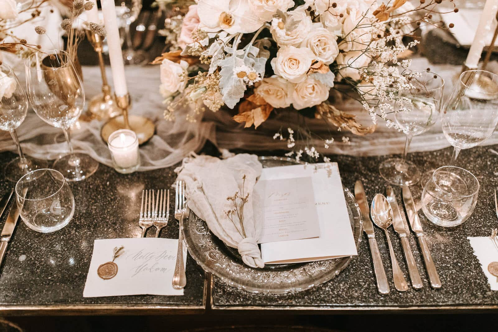 This closeup shows the place setting of the wedding.
