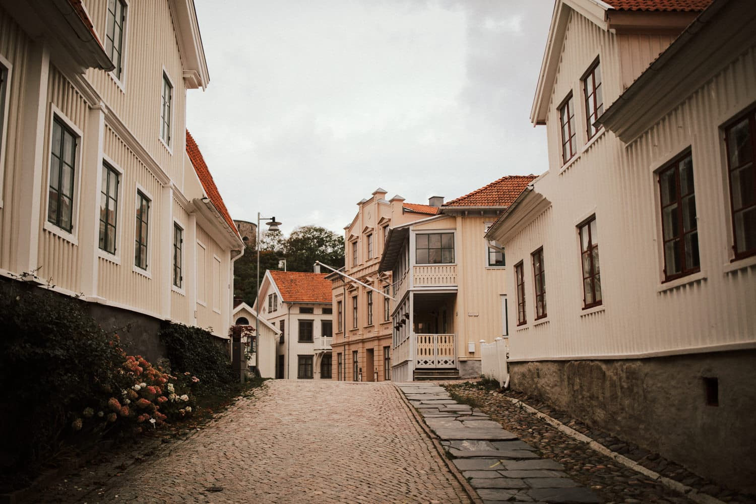 The wedding location features a rough road in the middle of old buildings.