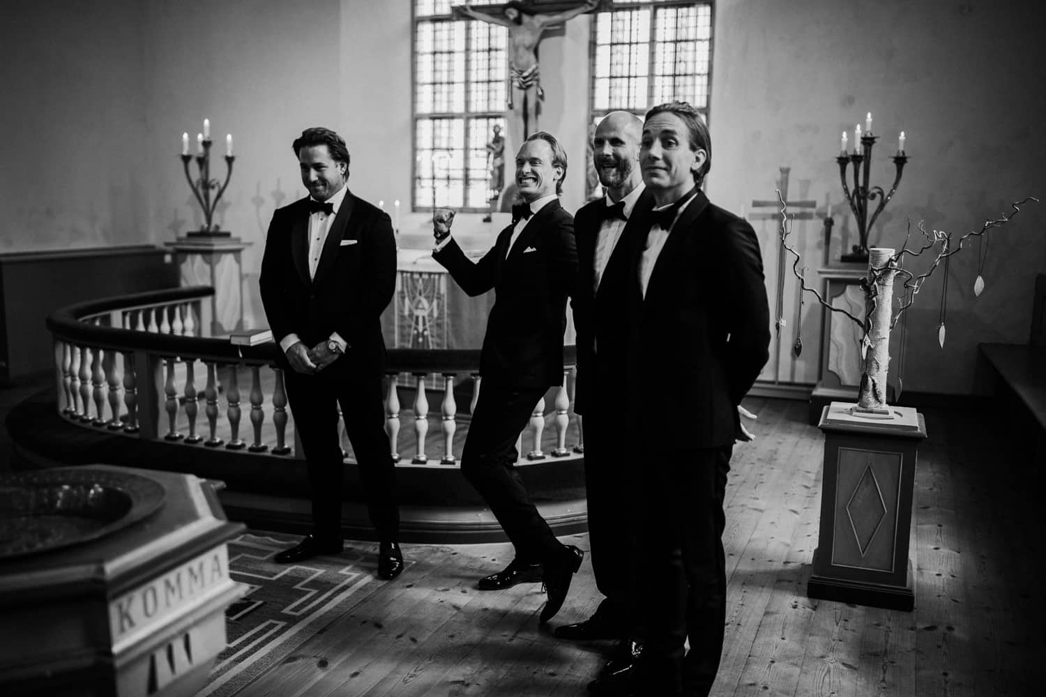 The groom and his groomsmen are waiting for the bride at the altar.
