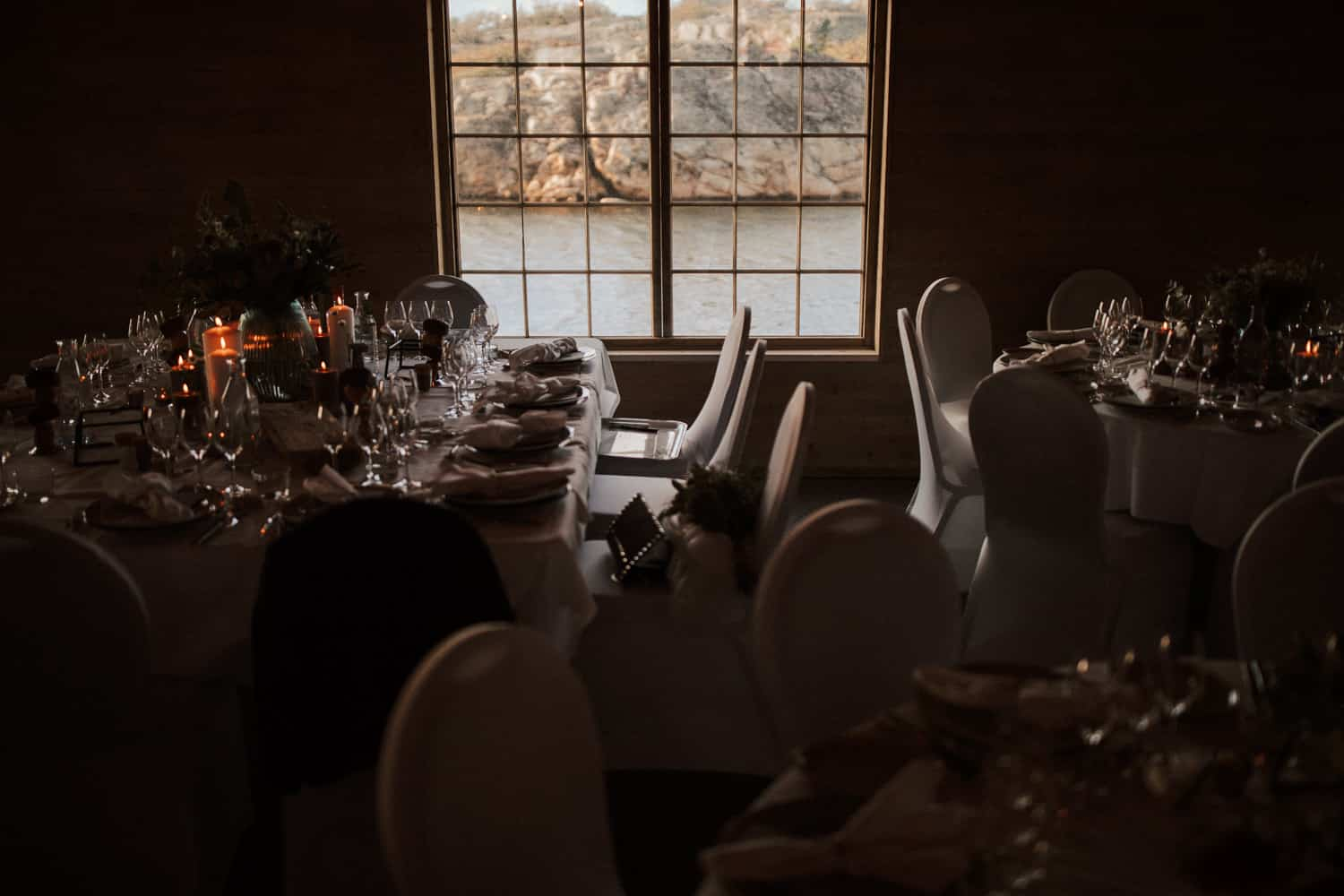A room is equipped with wedding tables and chairs.