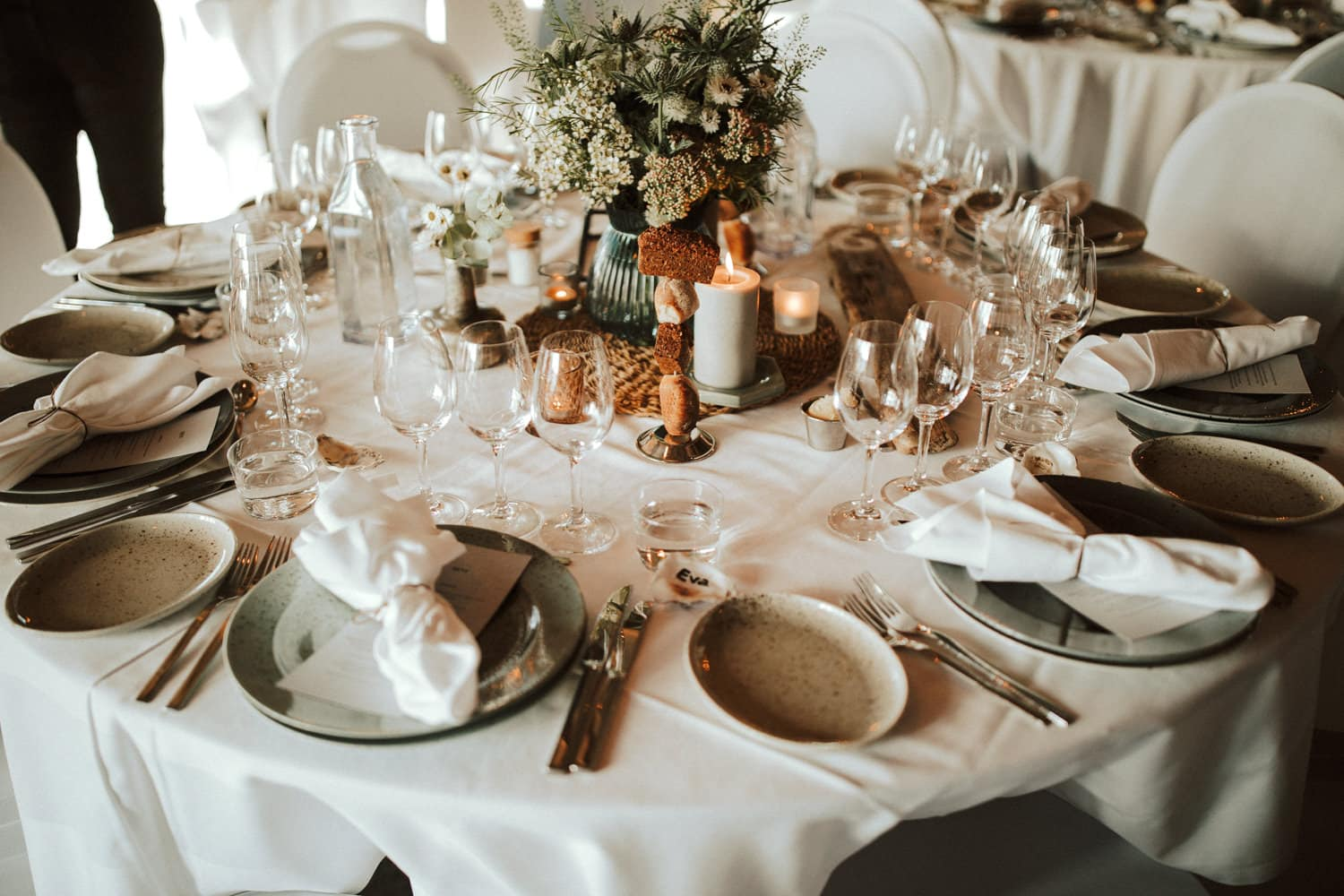 A closeup shows wedding place settings.