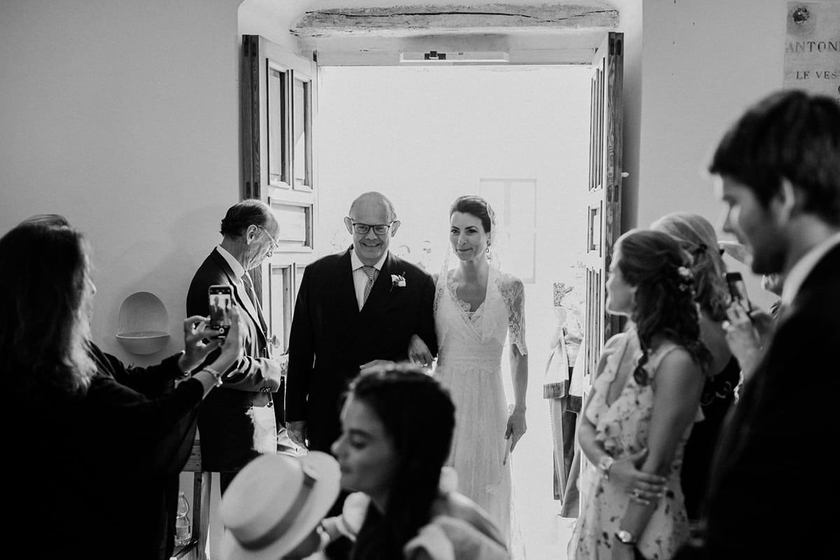 The bride and der father are entering the church.