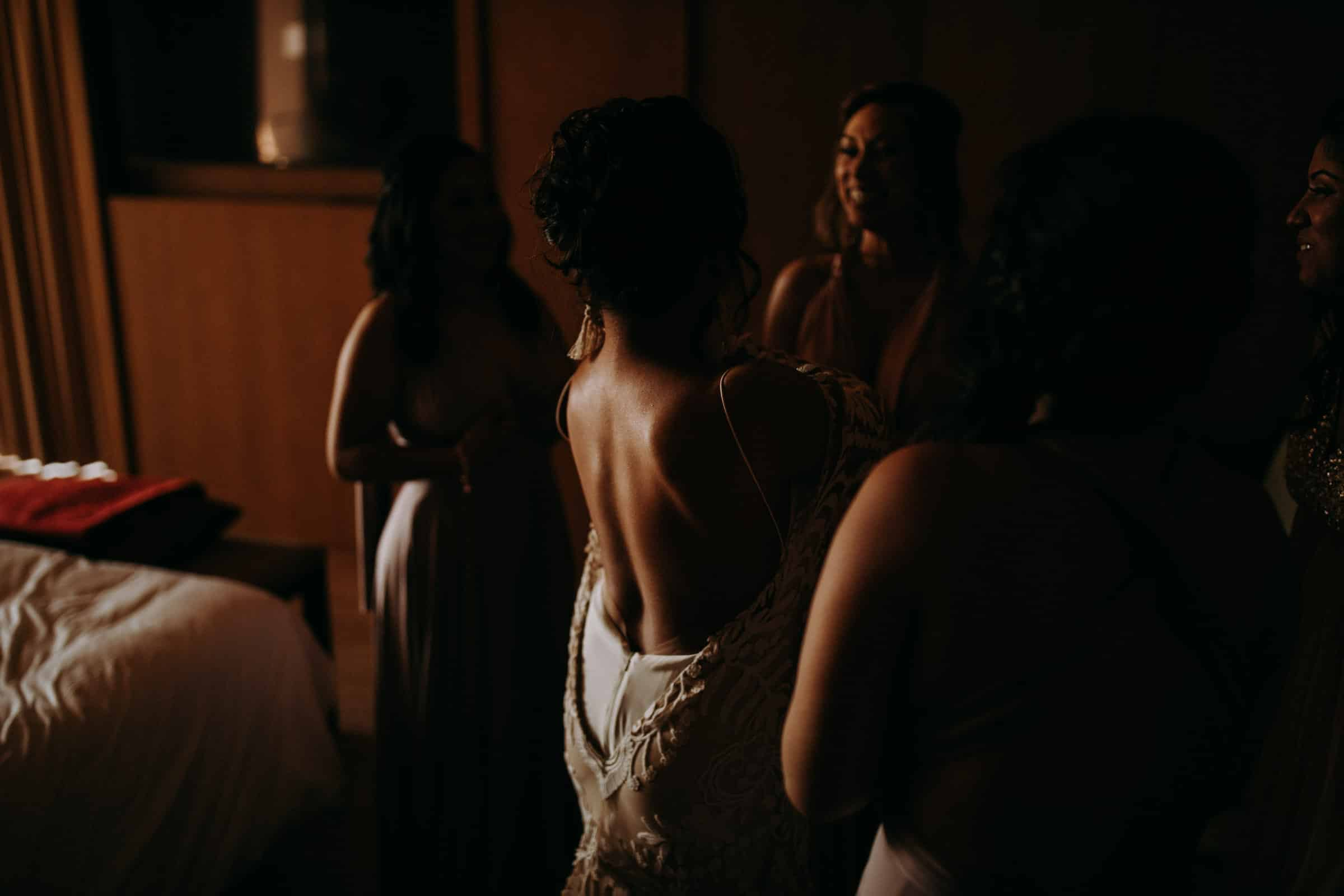A bride is getting dressed.