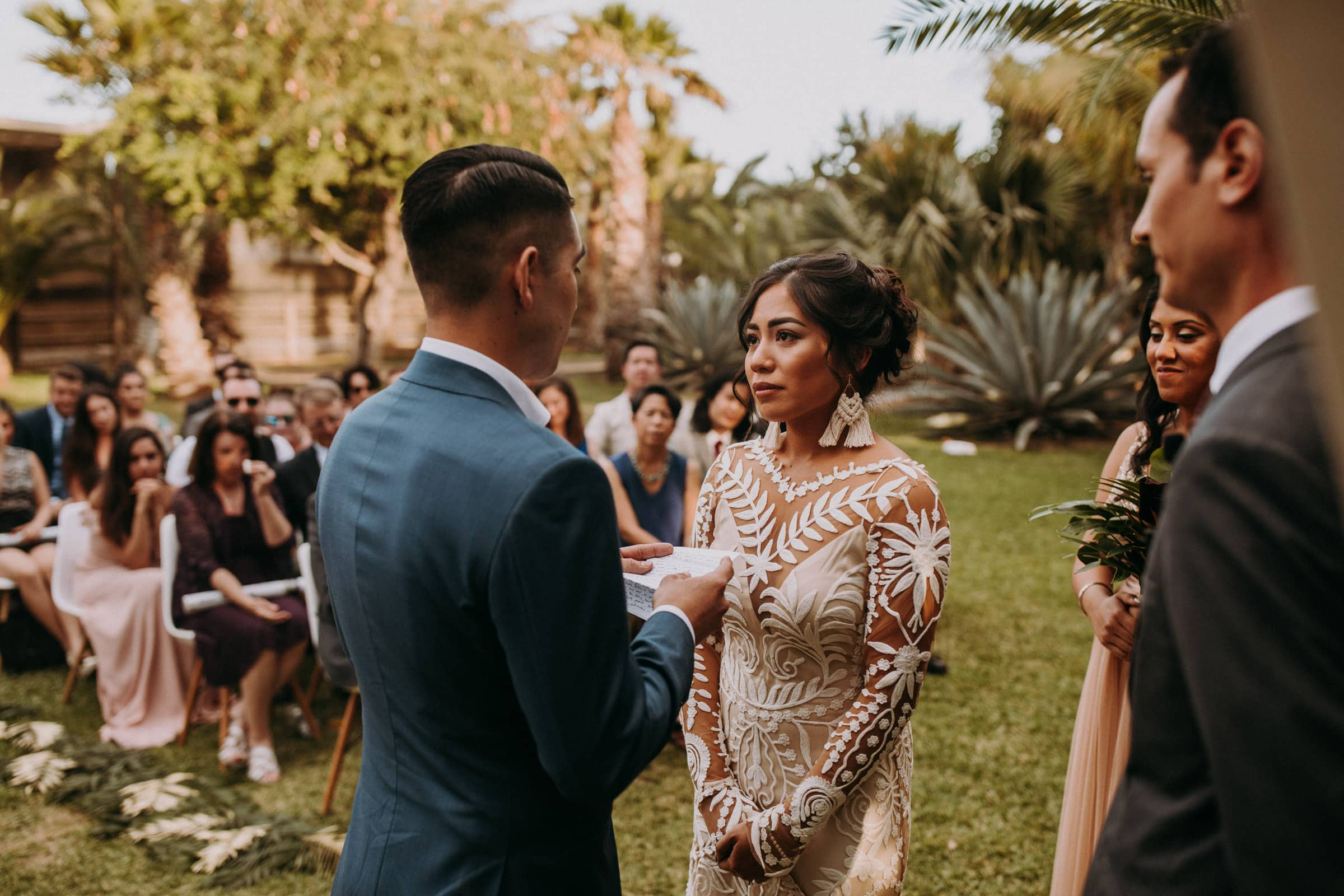 A wedding couple is exchanging vows at the San Jose Del Cabo Wedding.