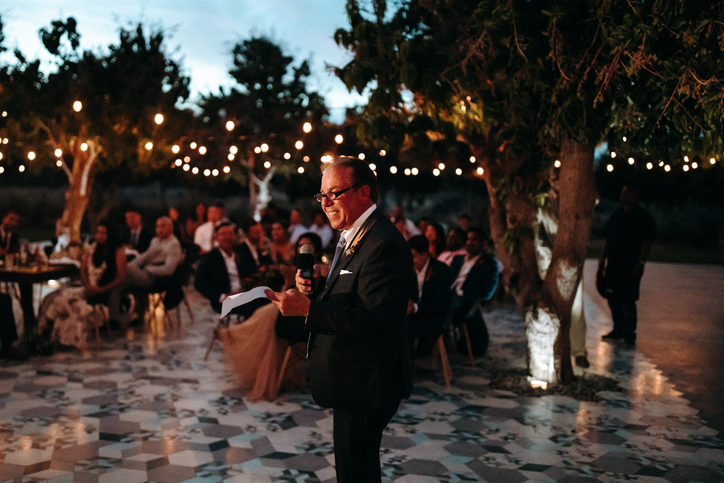 The father is holding a speech at the acre baja wedding.