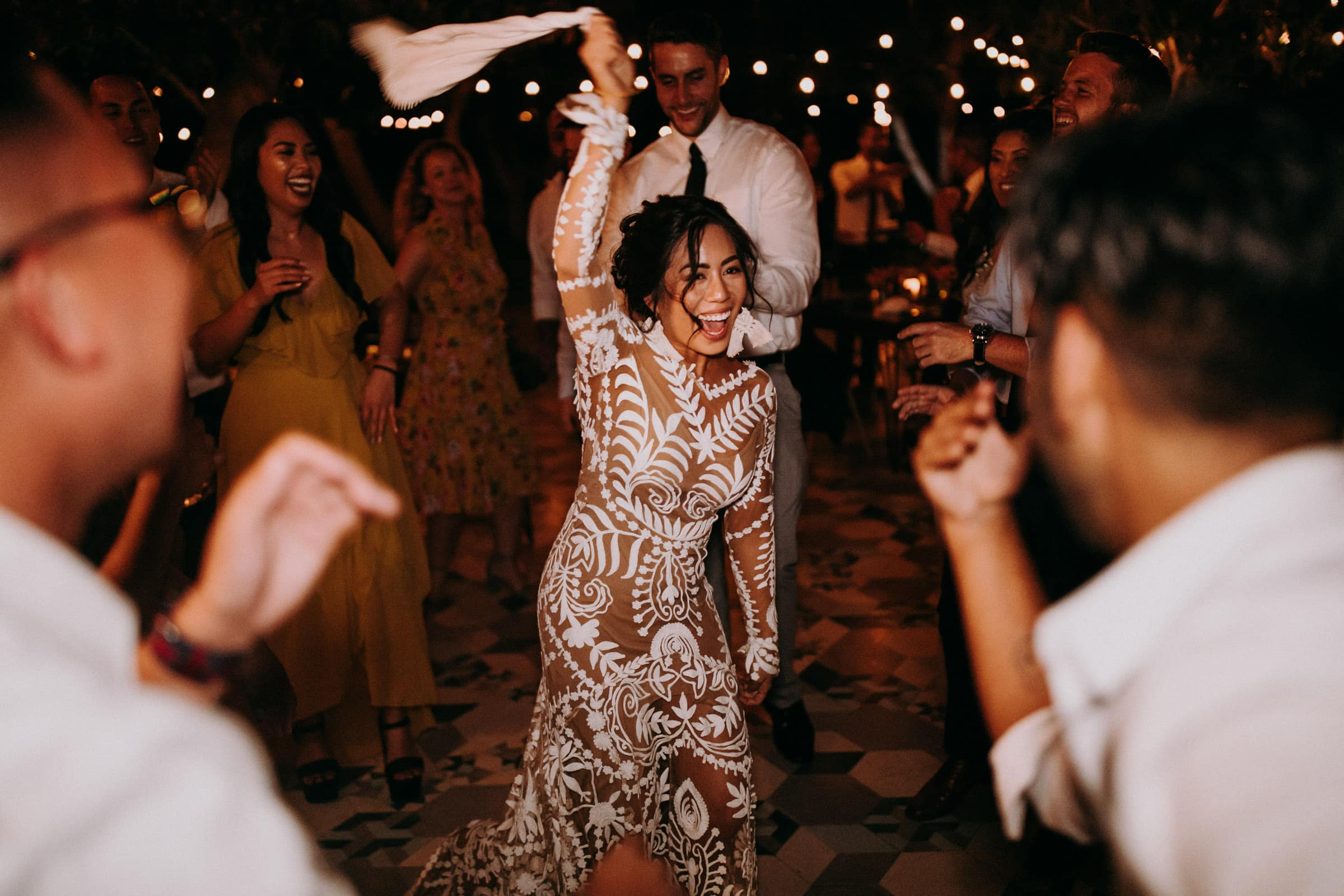 The bride is dancing next to her guest at the San Jose Del Cabo Wedding.