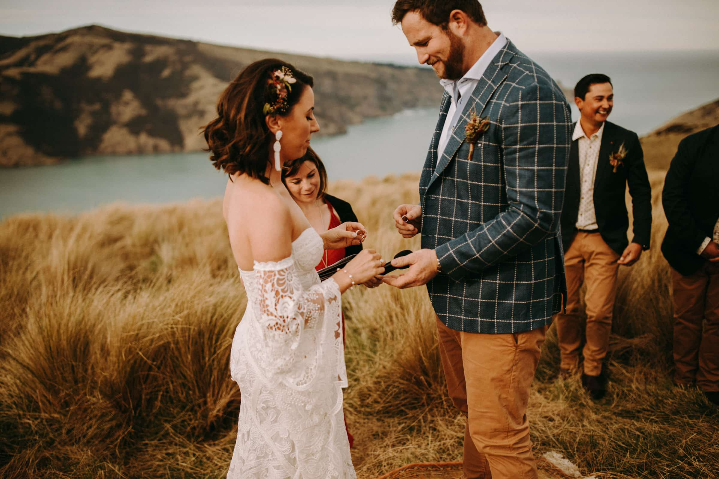 A wedding couple is exchanging wedding rings.