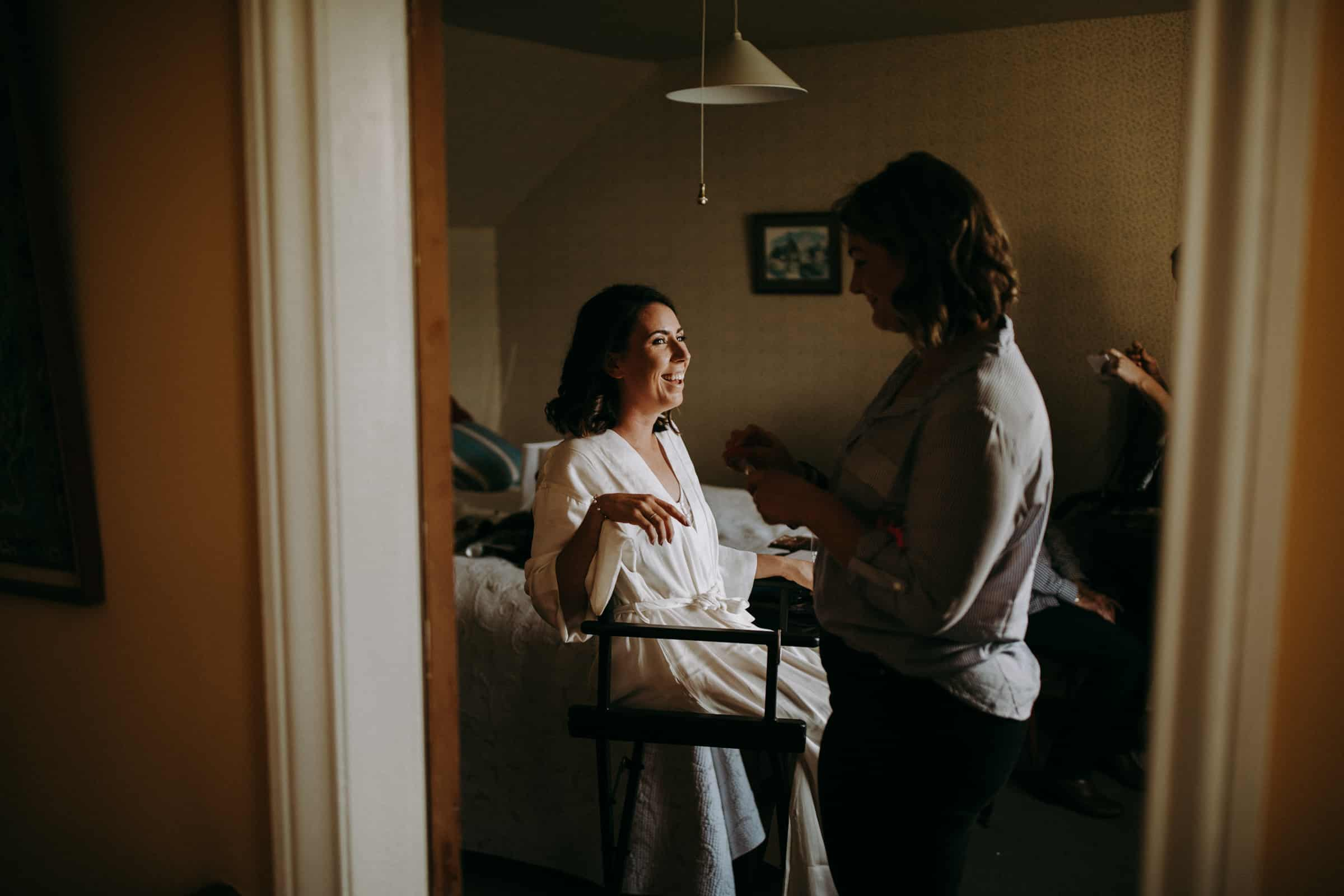 A bride is getting ready in a vintage room.