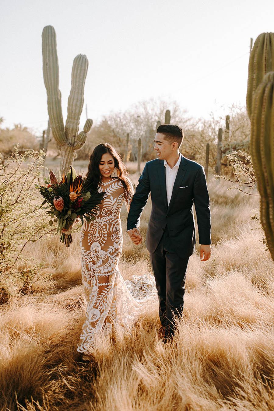 Wedding Couple walking in-between cactuses
